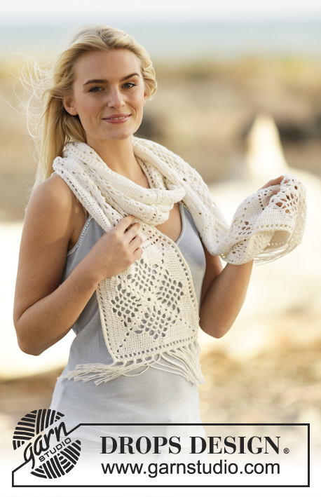 "Shining Bright / DROPS Extra 0-1126 - Crochet DROPS scarf with lace pattern and fringes in ""Safran""."