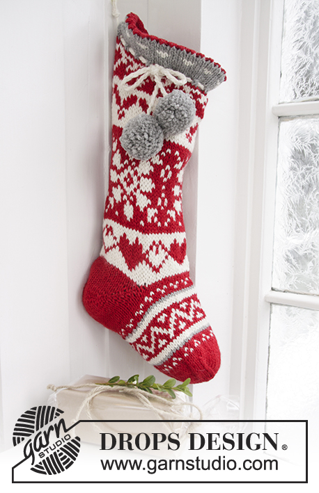 "Sweet Treasures / DROPS Extra 0-1192 - DROPS Christmas: Knitted DROPS Christmas sock with Nordic pattern and pompoms in ""Nepal""."