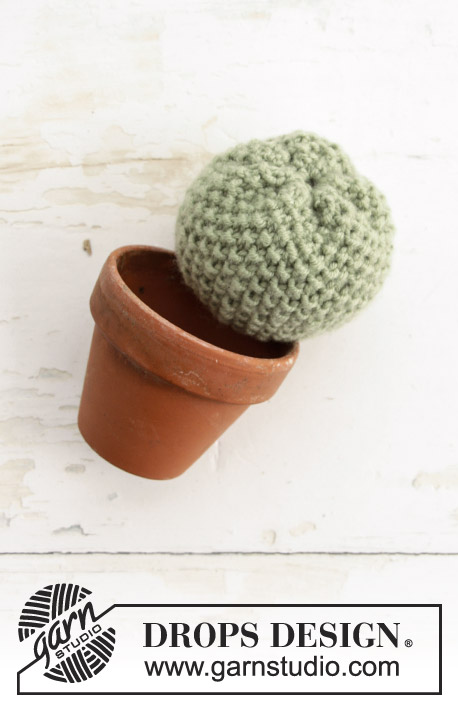 Poke Me / DROPS Extra 0-1387 - Knitted cacti with moss stitch, fisherman`s rib and garter stitch. The piece is worked in DROPS Merino Extra Fine.