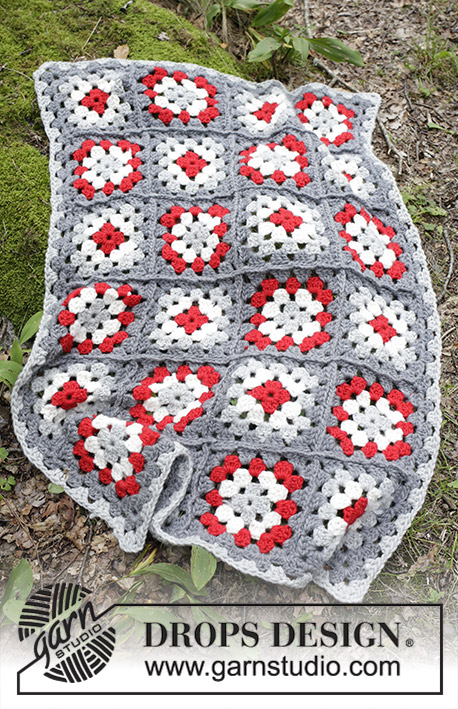 Cozy Holiday / DROPS Extra 0-1399 - Blanket with crochet squares for Christmas. The piece is worked in DROPS Eskimo.