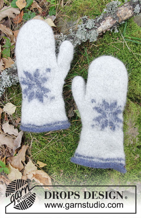 Icy Paws / DROPS Extra 0-1413 - Felted mittens with star for Christmas. Piece is knitted in DROPS Lima.