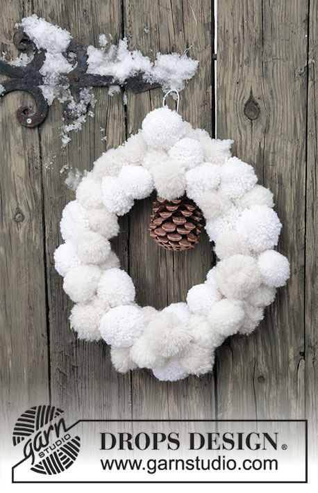 Snow Wreath / DROPS Extra 0-1416 - Door wreath made of pompoms for Christmas. Piece is made in DROPS Brushed Alpaca Silk, DROPS Nepal and DROPS Eskimo.