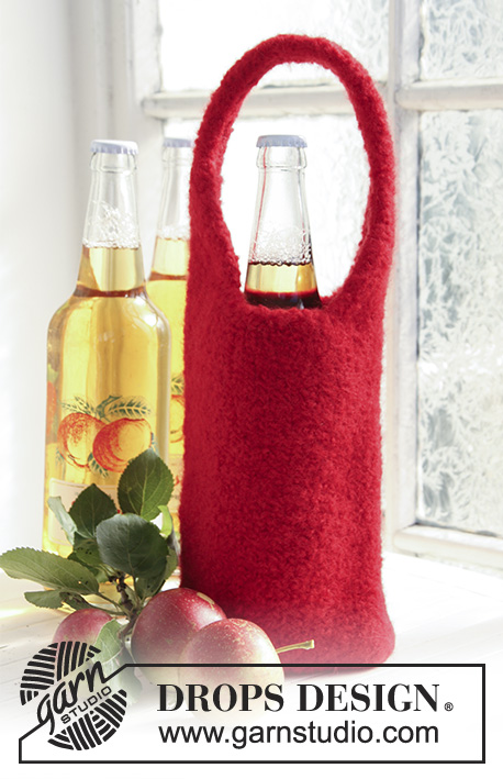 Take Me Home / DROPS Extra 0-729 - Knitted and felted bottle cover for wine bottle in DROPS Snow. Piece is worked with a handle and can be used as a bag or gift bag for wine bottle. Theme: Christmas