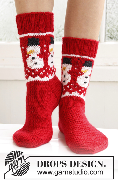 "Frosty Feet / DROPS Extra 0-786 - Knitted DROPS socks with Christmas pattern in ""Karisma""."