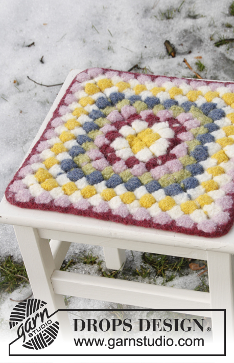 "Wildflower Seat / DROPS Extra 0-840 - Crochet DROPS seating pad for Easter in ""Eskimo""."