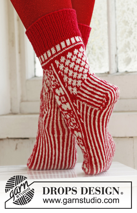 "On Your Toes! / DROPS Extra 0-860 - Knitted DROPS Christmas socks in ""Fabel"" size 35-43."