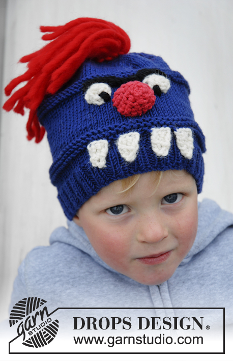 "Tooth Monster / DROPS Extra 0-931 - Knitted DROPS monster hat with teeth, nose, eyes and hair in ""Merino Extra Fine""."
