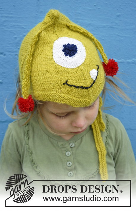 "Eye Smile / DROPS Extra 0-932 - Knitted DROPS monster hat with antennas, eyes and mouth in ""Alpaca""."
