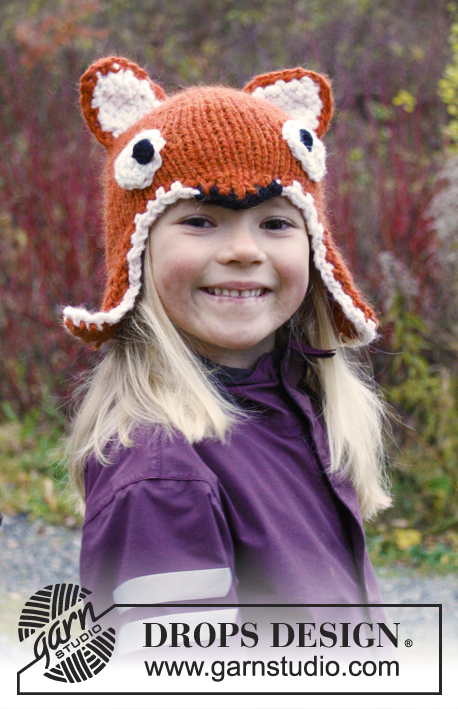 "Fawn / DROPS Extra 0-981 - Knitted DROPS fox hat with ear flaps and crochet edge in ""Andes"". 