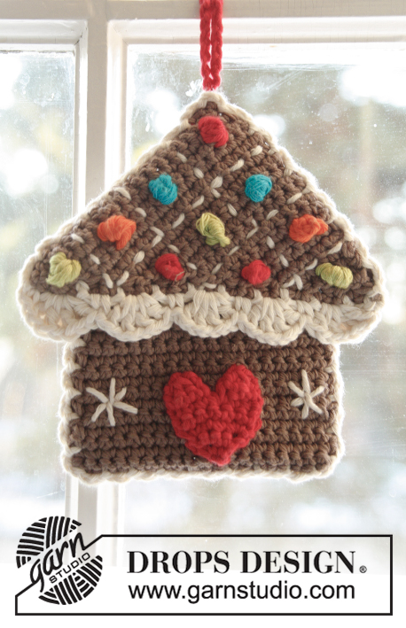 "Home Sweet Home / DROPS Extra 0-987 - DROPS Christmas: Crochet DROPS gingerbread house pot holder in 2 strands ""Safran"" and ""Paris""."
