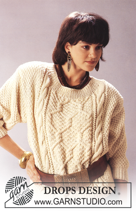 DROPS 10-2 - Knitted jumper with cables and Aran pattern in DROPS Paris. Size S – L.