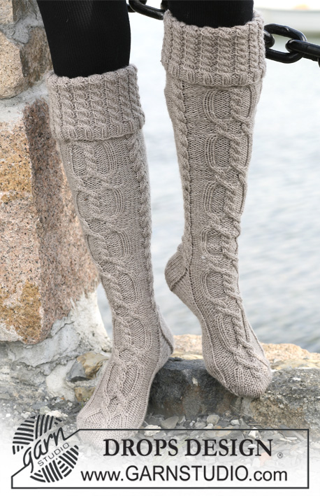 Knee High Boot Socks Knitting Pattern : DROPS 103-10 - Long DROPS socks in ?Karisma Superwash? with cables and folded...