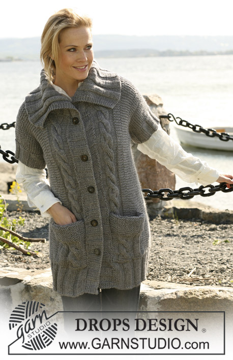 "DROPS 104-31 - Long DROPS jacket in ""Alaska"" with short sleeves and cables. Size: S to XXXL"