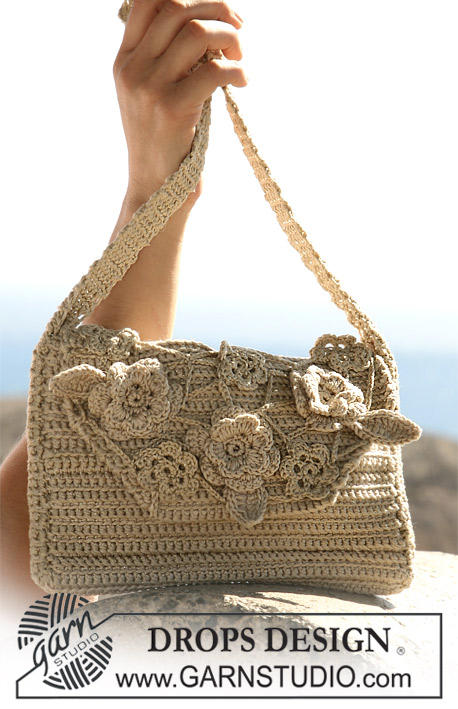"DROPS 105-17 - Crochet DROPS bag with flower attachments in ""Muskat"", ""Cotton Viscose"" and ""Glitter""."