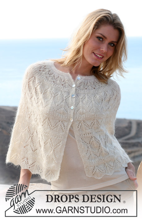 "DROPS 105-27 - DROPS short cape with lace pattern in ""Vivaldi"" and ""Glitter""."