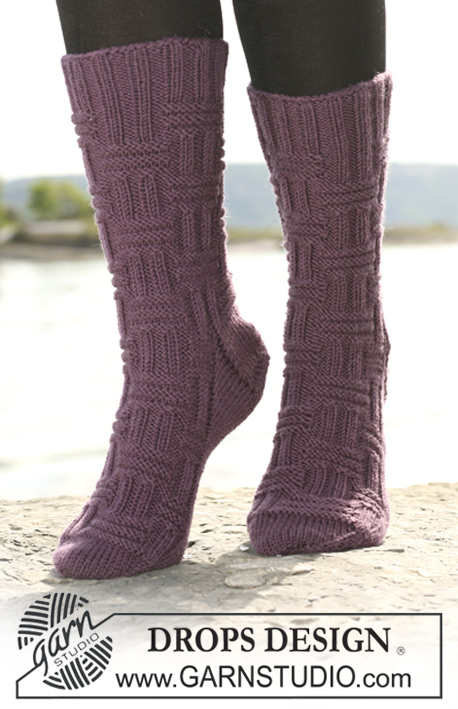 "DROPS 108-38 - DROPS socks with textured pattern in ""Merino"" or ""Karisma""."