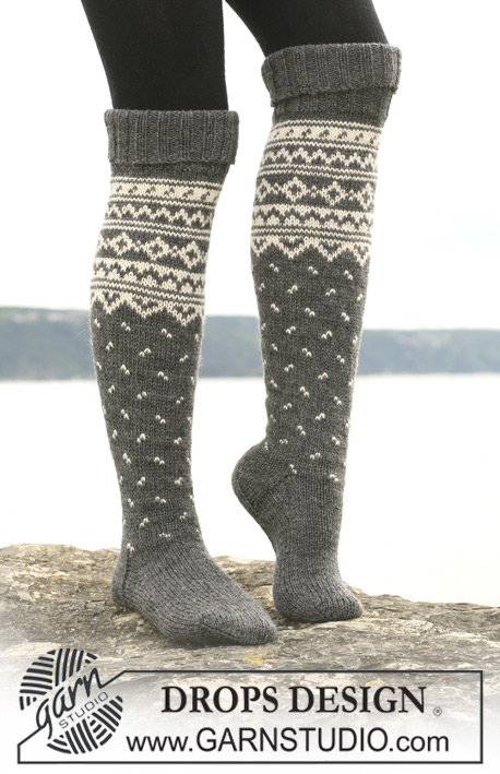 "DROPS 110-43 - Knitted DROPS socks with pattern borders in ""Karisma"". Yarn alternative ""Merino Extrafine""."