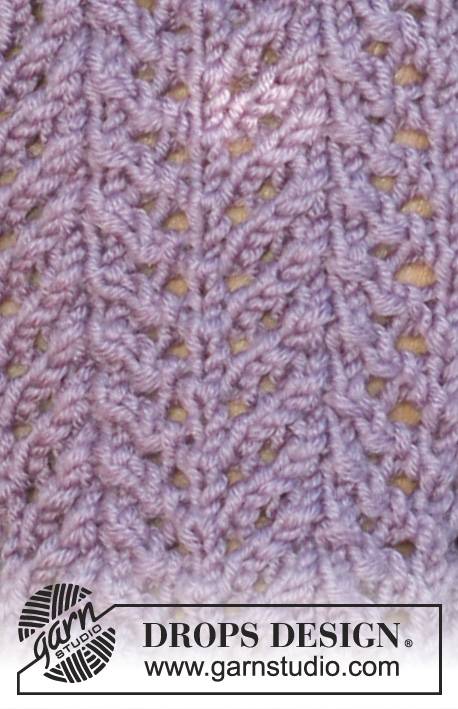 "Purple Rhapsody / DROPS 115-12 - DROPS hat and fingerless gloves with lace pattern in ""MERINO EXTRA FINE""."