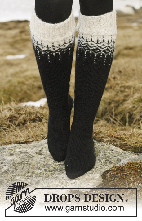 "Winter Fantasy / DROPS 116-1 - DROPS Jacket in ""Alpaca"" and ""Glitter"" with 2-colour pattern in round yoke. Size S to XXXL. Long socks in ""Fabel"" with the same pattern."