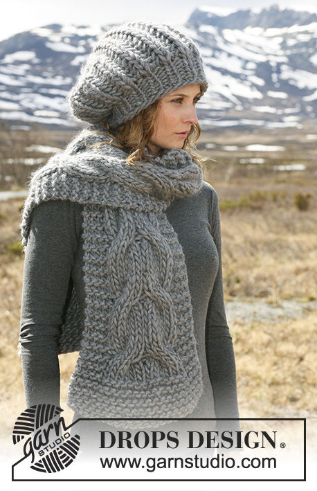 "Colombelle / DROPS 116-15 - Set comprises: Knitted DROPS hat in English rib and scarf with cables in ""Polaris""."