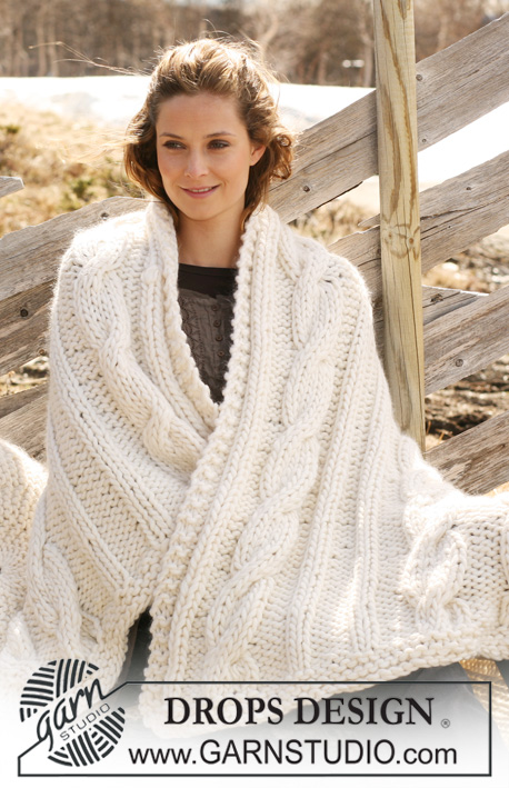 "Cuddle Me / DROPS 117-55 - Knitted DROPS blanket in ""Polaris"" with cables."