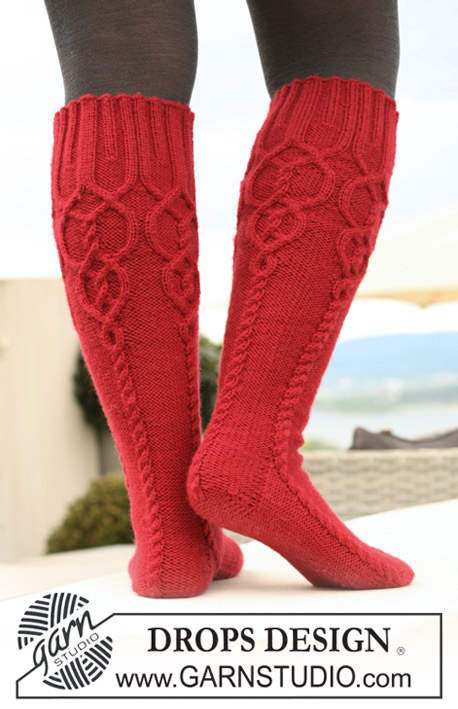 "Celtic Red / DROPS 122-27 - Knitted DROPS socks in ""Karisma"" with cables."