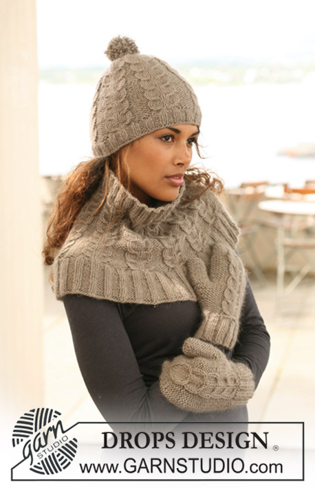 "DROPS 125-12 - Set comprises: Knitted DROPS hat, neck warmer and mittens with cables in ""Merino Extra Fine"" and ""Kid-Silk""."