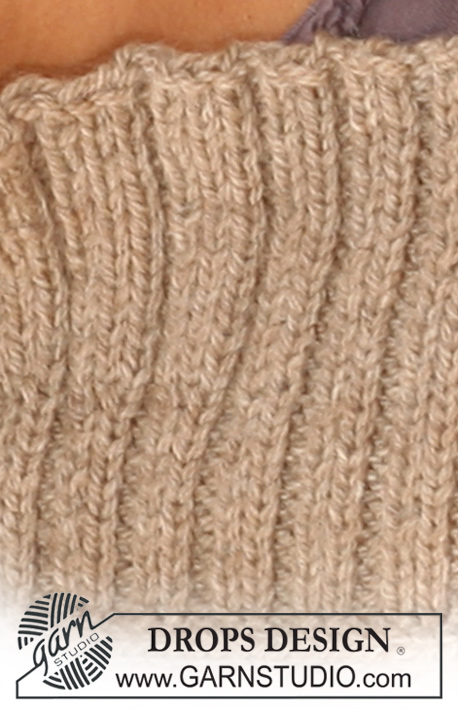 "Trip to Town / DROPS 126-15 - DROPS jacket in stockinette st with front bands in  rib in 2 strands ""Alpaca"" or 1 strand ""Nepal""."