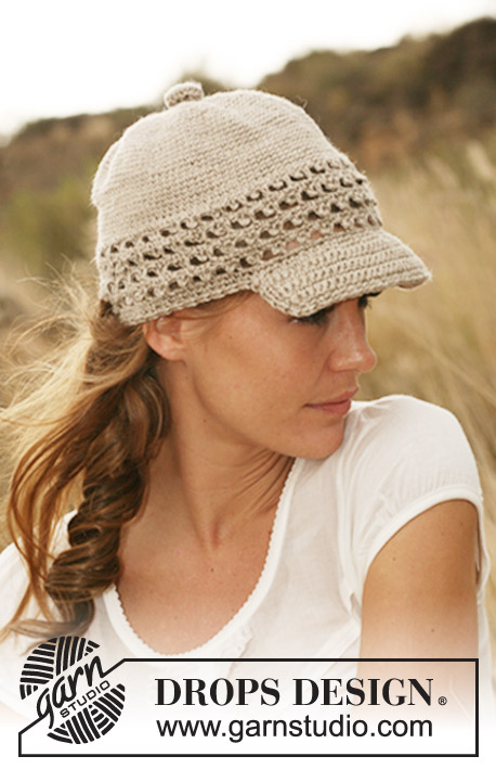 Let's Safari / DROPS 127-45 - Crochet DROPS cap with brim and lace pattern border in Lin.