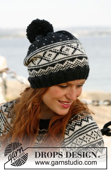 Nordic Night / DROPS 131-13 - Knitted DROPS hat with Norwegian pattern and large pompom in Karisma.
