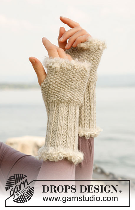"Elegance / DROPS 131-31 - Knitted DROPS wrist warmers in ""Nepal"" with crochet border in ""Puddel""."