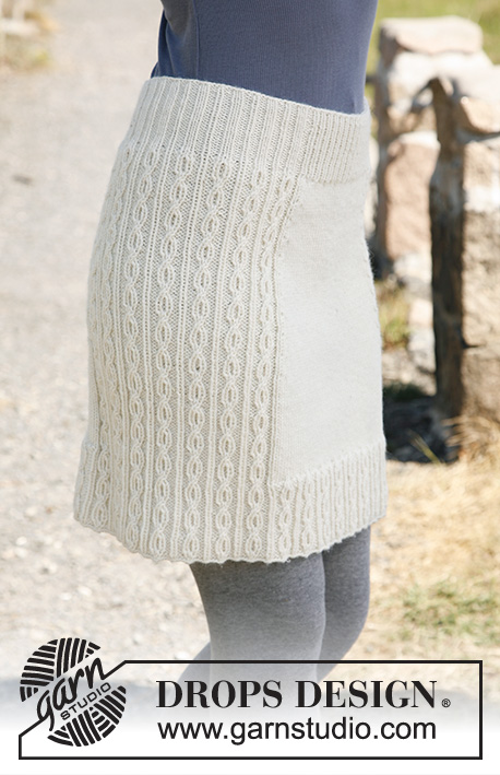"Belle / DROPS 131-5 - Knitted DROPS skirt with cable pattern in ""Karisma"". 