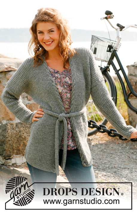 "DROPS 132-23 - Knitted long DROPS jacket or vest with textured pattern, cable edge and belt in ""Karisma"". Size: S to XXXL."