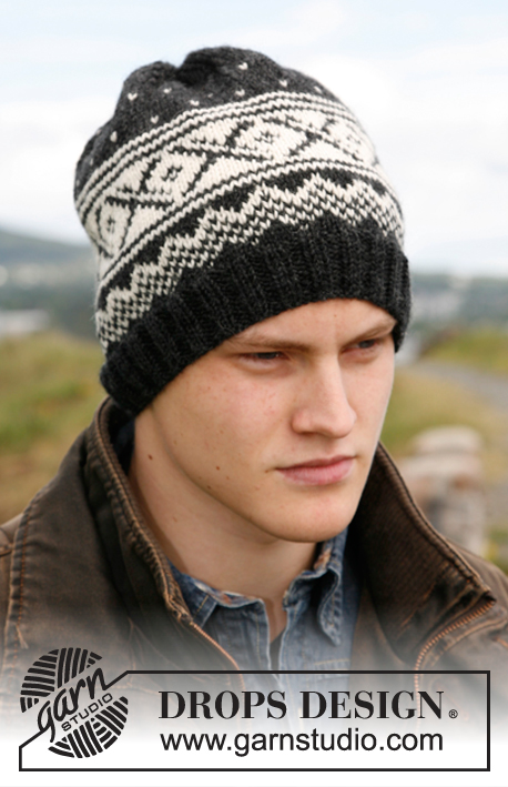 Reynald / DROPS 135-6 - Knitted DROPS hat with Norwegian pattern in Karisma.
