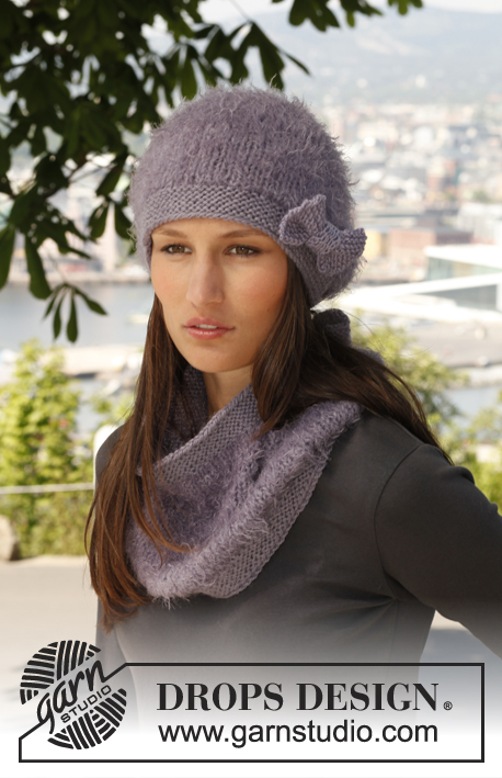 "Serenas Comfort / DROPS 140-15 - Set consists of: Knitted DROPS hat, neck warmer and wrist warmers in ""Symphony"" or Melody and ""Nepal"".."