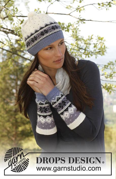 "Chamonix / DROPS 142-16 - Knitted DROPS wrist warmers and hat with Norwegian pattern in ""BabyAlpaca Silk""."