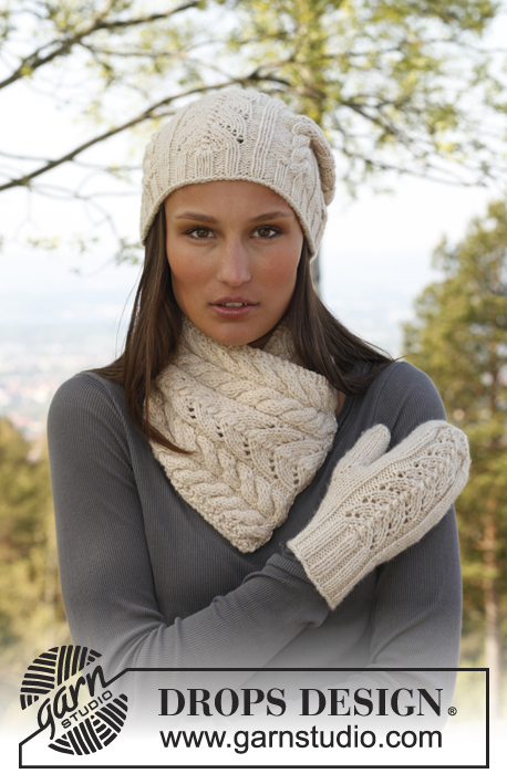"Solveig / DROPS 142-17 - Knitted DROPS hat, neck warmer and mittens with lace pattern in ""Nepal""."