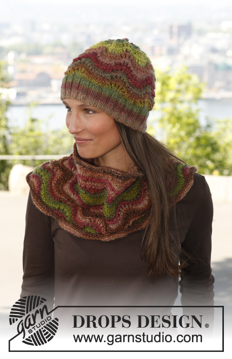 "Autumn dream / DROPS 143-6 - Knitted DROPS scarf and wrist warmers in wave pattern in ""Big Delight ""."