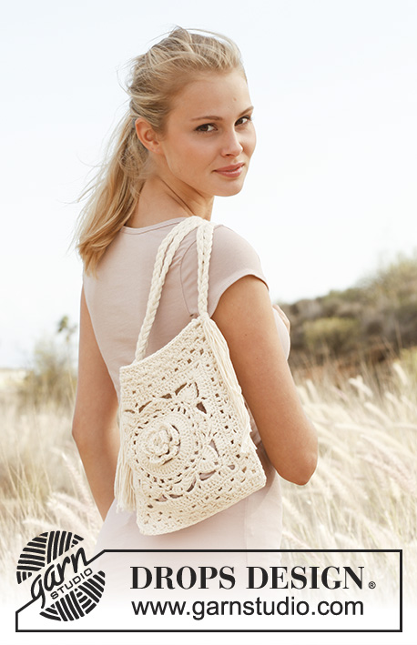 Jude / DROPS 146-13 - Crochet DROPS bag with plaited shoulder strap in Paris.