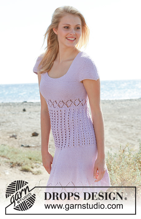 "Emma / DROPS 148-12 - Knitted DROPS dress in garter st with short sleeves and lace pattern in ""Cotton Light"". Size: S - XXXL."