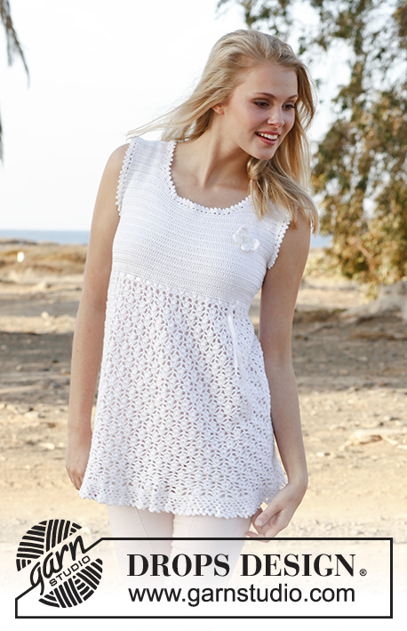 "Yasmin / DROPS 148-9 - Crochet DROPS tunic with lace pattern, flounce at the bottom and butterfly for decoration in ""Cotton Viscose""."