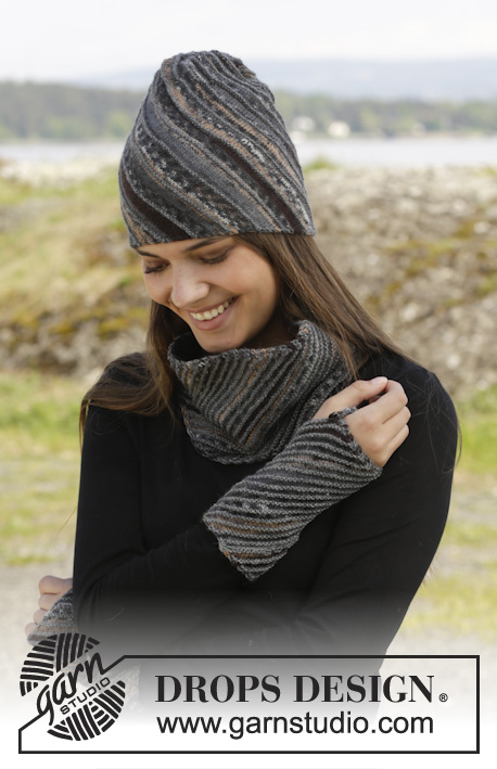 "Erin / DROPS 157-44 - Knitted DROPS hat, neck warmer and wrist warmers in stockinette st with diagonal ridges in ""Fabel""."