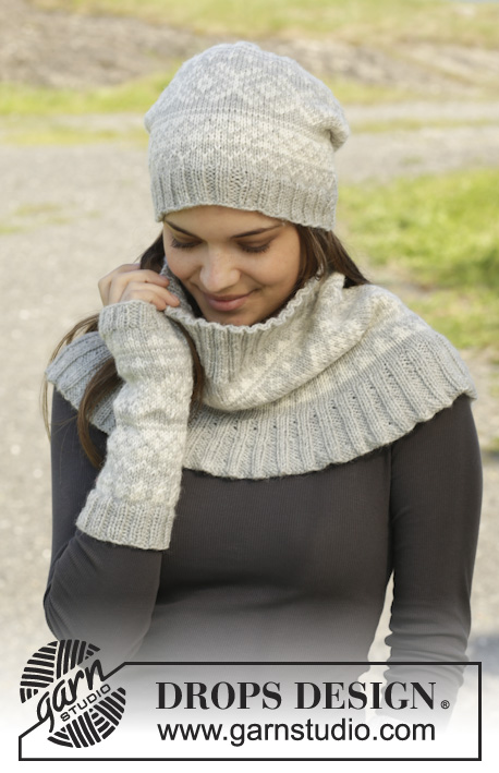"Silver Dream Set / DROPS 157-9 - Knitted DROPS hat, neck warmer and wrist warmers with Norwegian pattern in ""Karisma""."