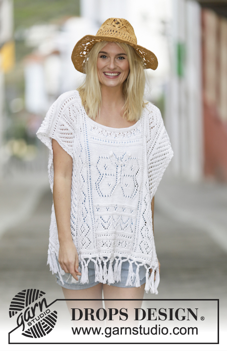 "Riviera Maya / DROPS 159-1 - Knitted DROPS poncho with lace pattern and fringes in ""Cotton Light"" or Belle. Size: S - XXXL."