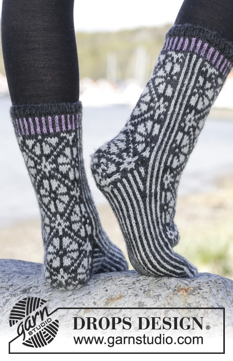 "Starry Night Socks / DROPS 166-25 - Knitted DROPS socks with Nordic pattern in ""Karisma"". Size 35-43"