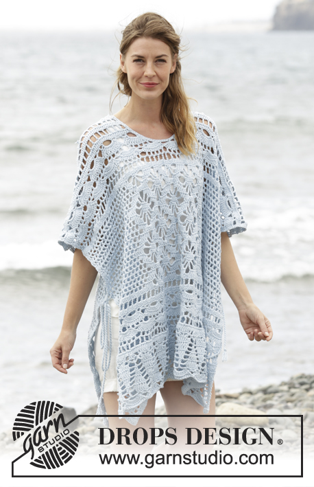 "Graceful Mermaid / DROPS 168-29 - Crochet DROPS poncho with lace pattern, worked top down in ""Cotton Merino"". Size: S - XXXL."