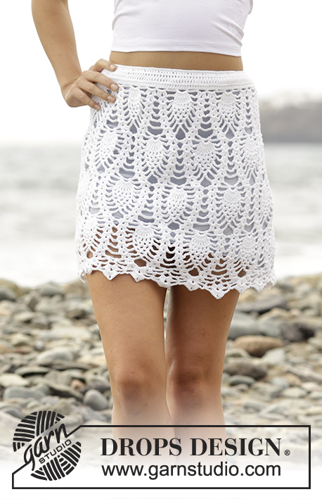 "Piña Colada / DROPS 169-21 - Crochet DROPS skirt with lace pattern and overlap, worked top down in ""Safran"". Size S-XXXL."