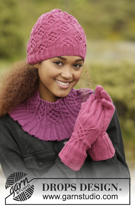 Vadelma / DROPS 172-44 - Set consists of: Knitted DROPS hat, neck warmer and gloves with cables in BabyMerino.