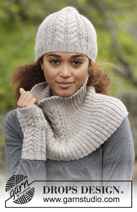 "Winter Wired / DROPS 173-21 - Knitted DROPS hat, neck warmer and wrist warmers with cables in ""Puna""."