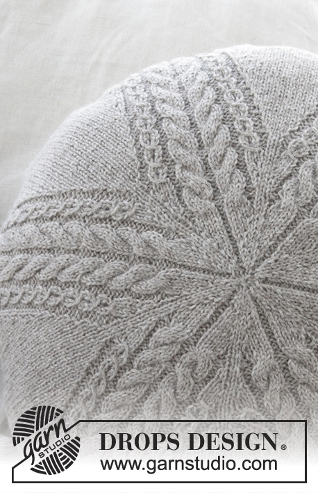 Sand Tracks Pillow / DROPS 178-38 - Round pillow with cables, worked in the round in DROPS Puna.